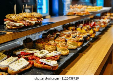 Spanish tapas called pintxos of the Basque country served on a bar counter in a restaurant in San Sebastian, Spain