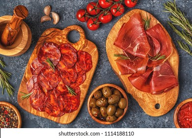 Spanish tapas with  chorizo,  jamon, picnic table, top view.