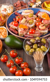 Spanish tapas food starters with tomatoes, prawns, avocado and open sandwiches