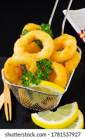 Spanish Tapas. Fried Squid Rings in a basket. Calamares a la Romana.