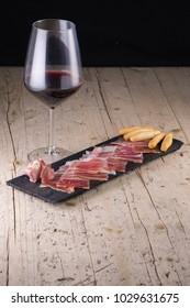 Spanish tapas, iberian loin, sausage. Iberian Acorn Ham and wine