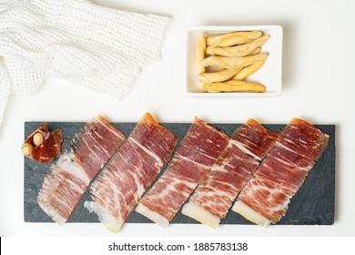 tapas españolas, lomo ibérico, salchichas. Acorn Ham Ibérico