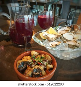Spanish tapas, oysters and sangria