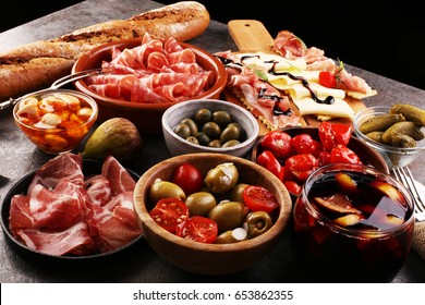 spanish tapas and sangria on wooden table