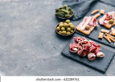 Spanish tapas: slice of bread, cheese and spanish ham.