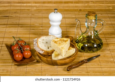 Spanish tortilla skewer presented in typical ration of Spain, With pure olive oil salt and bread with tomato
