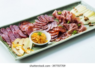 spanish traditional smoked meats serrano ham chorizo and cheese platter starter dish with quince jam and bread