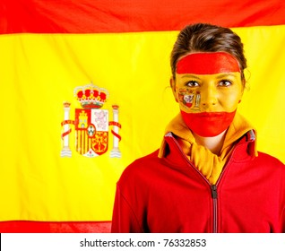 Spanish woman with the flag behind her and paint on her face