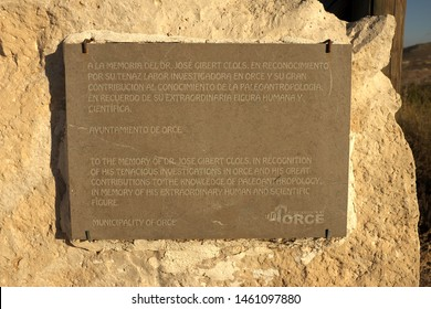 Spanish-English bilingual plaque in honor of Dr. Jose Gibert Clols in recognition of his tenacious investigations in Orce and his great contributions to knowledge of paleoanthropology. Orce Spain 2017
