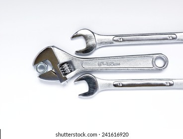 Spanner with nut and wrench tool isolated on white background