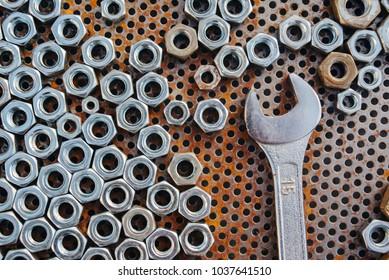 Spanner wrench between metal nuts