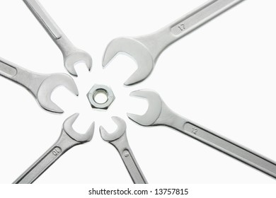 Spanners and Nut on Seamless White Background