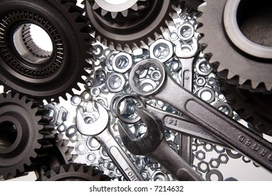 Spanners, nuts and gears on white