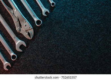 Spanners on a dark background. Top view, flat design. Automotive concept. Copy space.