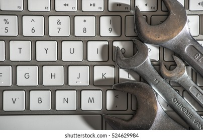 Spanners and white keyboard.
