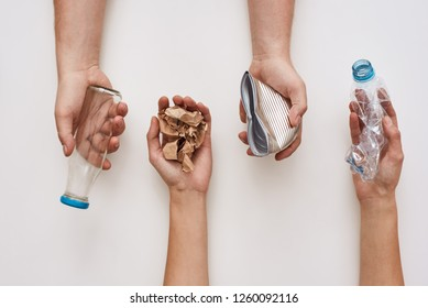 Sparate your trash. Four types of garbage in human hands