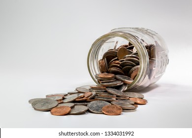 spare change spilling out of coin jar