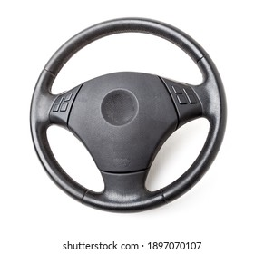 Spare part and interior element of a car steering wheel with leather trim and buttons with airbag on a white isolated background. Auto service industry. Catalog of junkyard.