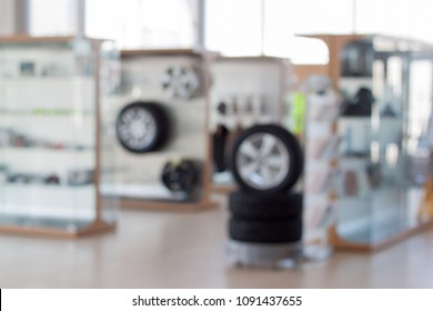 Spare parts and accessories for vehicles. Autoshop. Themed blur background.
