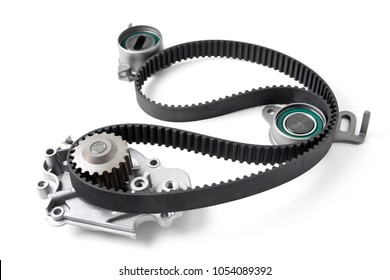 Spare parts for the ca r. Kit of timing belt with rollers on a light background  .