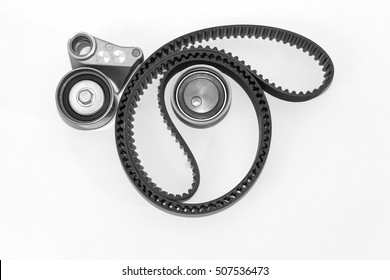 Spare parts for the car. Kit of timing belt with rollers on a light background.