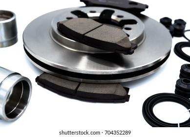 Spare Parts of disk brake pads, disc brake caliper piston, disk brake repair kIt and rotating brake disk.