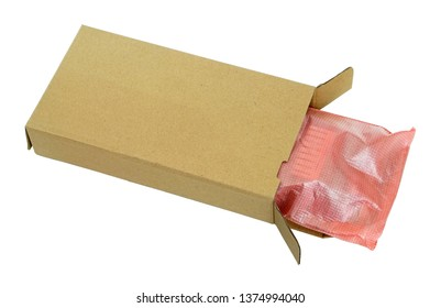 Spare parts and electronic components packed in soft film and carton box. Isolated with patch industrial macro