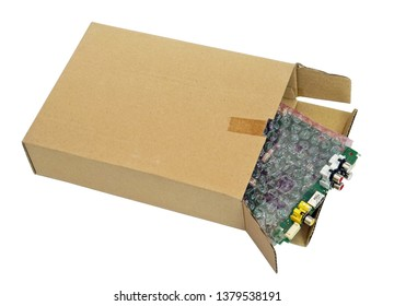 Spare parts and electronic video  components packed in soft red bag  and cardboard  box. Isolated with patch industrial macro