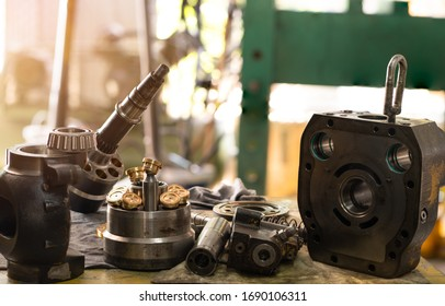 spare parts of the hydraulic piston pump on working, inspection and repair maintenance heavy machinery