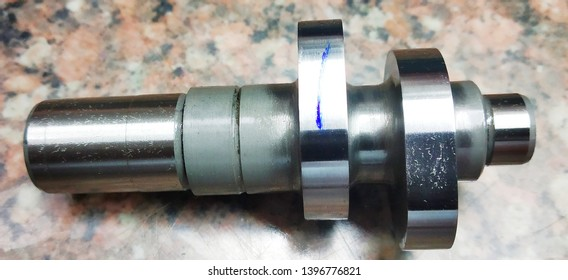 spare parts of scooty camshaft isolated on mist background