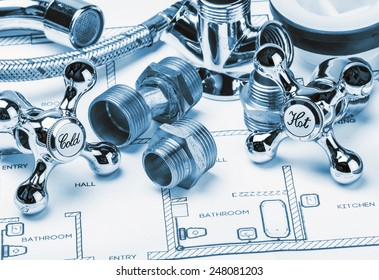 spare parts and tools lying on drawing for repair plumbing. toning image