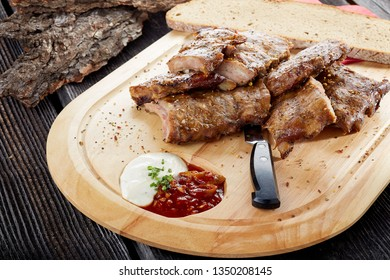 Spare ribs close up on wooden board