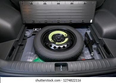 spare tire in the trunk of the car