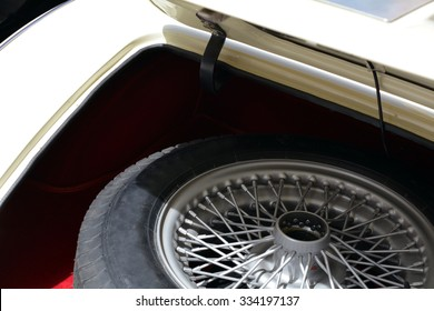 Spare tire in the trunk of a car.