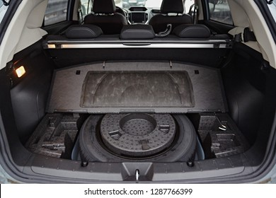 Spare wheel in the trunk of a modern car
