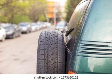 spare wheels or tires behind off road car