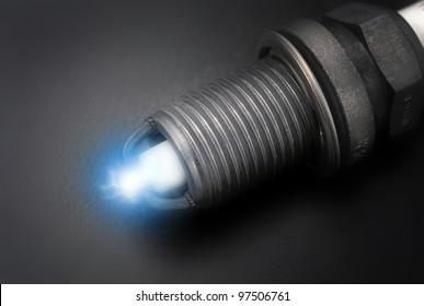 Spark plug on black background close up