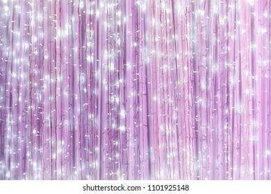 Sparking pink and purple light bulb decoration on wall backdrop / abstract pink background