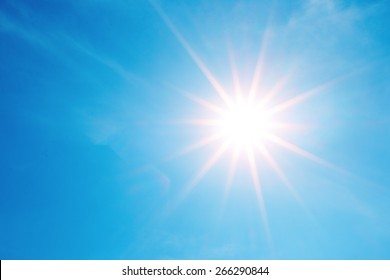 sparkle bright sun over clear blue sky