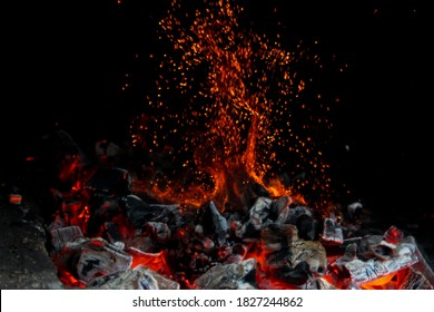 Sparkle of fire and coal burning