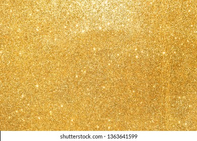 sparkle of golden glitter abstract background