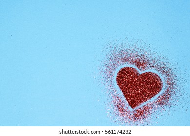Sparkle red heart on a blue background with copy space. Valentines day card with copy space.