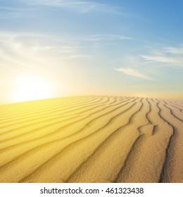 sparkle sunset over a sand desert