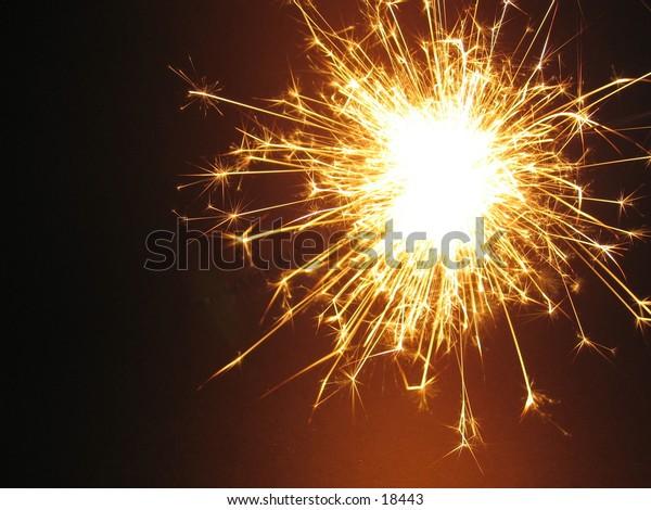 A sparkler against a black background.