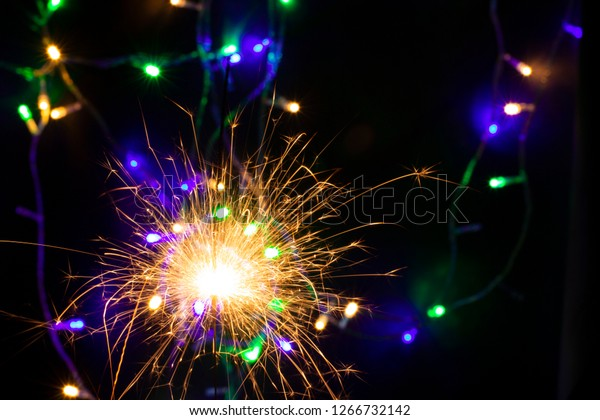 sparkler with blur new year's light close up