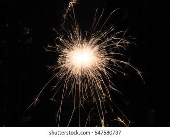 Sparkler burning on the black background