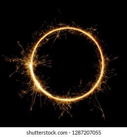 Sparkler circle shape. Burning bengal fire round letter o number zero, long exposure. Burning sparklers isolated on black.