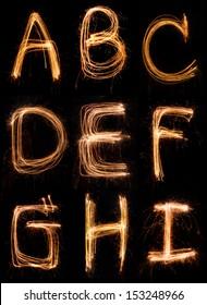 sparkler firework light alphabet  A-I