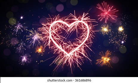 sparkler heart shape and fireworks. Computer generated festive background