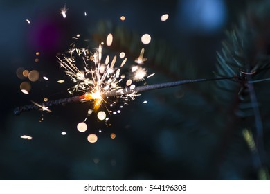 sparkler on christmas tree on colorful blurry background
